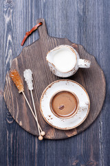 Coffee with milk on a vintage wooden board