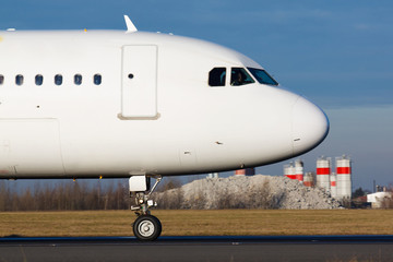 Detail of white plane nose during taxi on taxiway