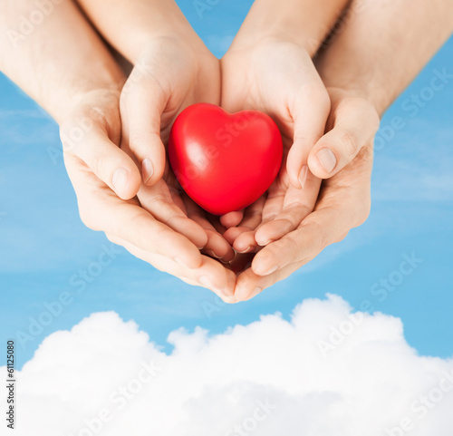 woman and man hands with heart