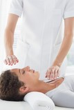 Woman receiving alternative therapy