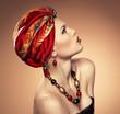 Portrait of ethnic dresses pretty woman wearing jewelery