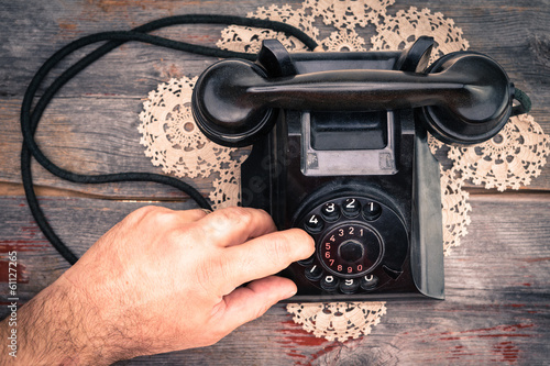 Man making a call on a rotary telephone