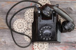 Old rotary telephone with the handset off the hook