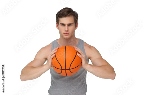 Fit man holding basketball about to throw