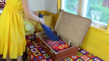 rural villa room girl packs the old grandmother's suitcase