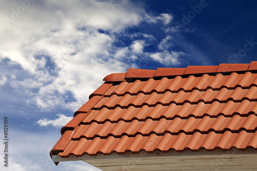 Roof tiles and sky with clouds at sunny day