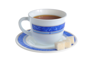 A cup of tea and refined sugar on saucer isolated on white