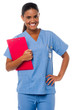 Female nurse holding clipboard, at duty