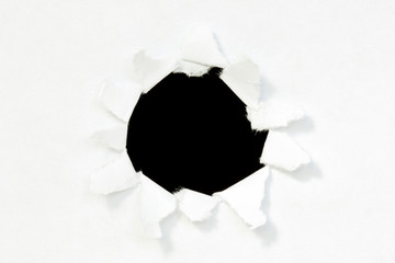 Paper with black hole inside