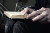 Hands of a man holding a book