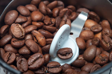 Macro electric grinder machine with coffee beans