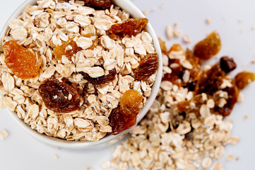 Oatmeal with raisins isolated on a light background