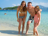 Portrait of happy family on tropical beach