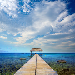 Calm scene with jetty and ocean in tropical island