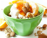 Bowl of Muesli with Yogurt and Fruits