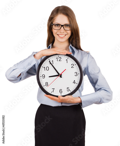 Smiling young woman holding a clock