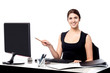 Businesswoman holding pen and pointing monitor