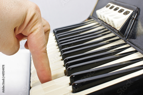 Playing on accordion keyboard