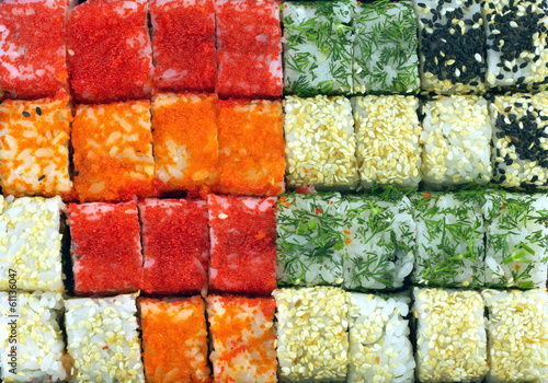 Many sushi rolls as background closeup