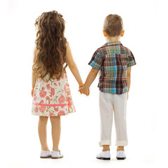 Back view of little kids holding hands