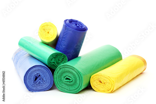 A lot of garbage bags rolls on a white background - 61136862
