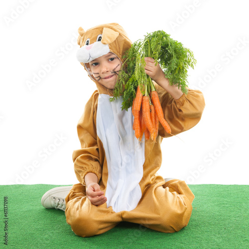 Child as easter hare with carrots