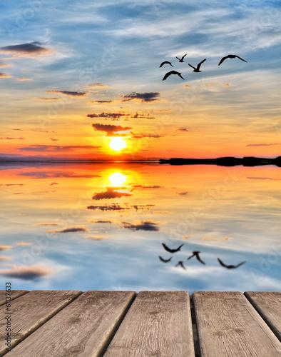 Fotobehang Een Hoekje om te Dromen puesta de sol de colores en el mar