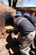 Indian men cook in Clay Oven in Bolivia, South America