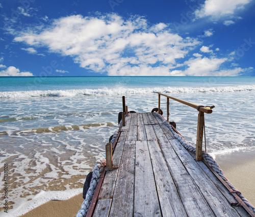 In de dag Strand embarcadero de madera en la playa