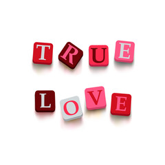 "Words ""true love"" with colorful blocks"
