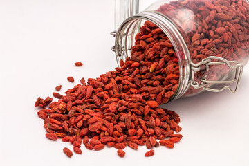 Superfood Goji Berries falling out of a jar