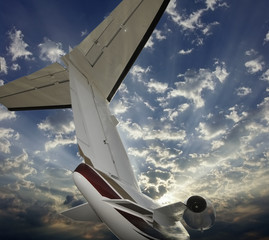 Executive aircraft tail at sunset