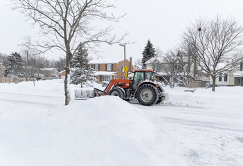 Snowplow Clearing the Street After a Snow Storm