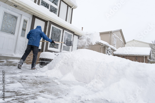 Man Clearing Snow With a Shovel
