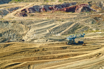 Surface mine with exposed colored minerals