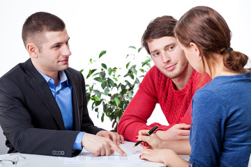 Couple signing the mortgage agreement
