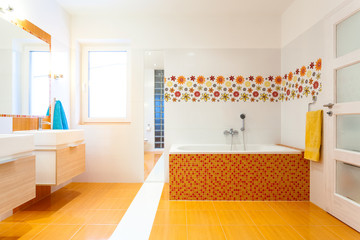 New contemporary bathroom with orange tiles