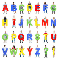 Multi-ethnic group of people holding alphabet