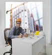 architect engineer working in office room against building const