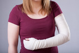 Woman with bandaged arm