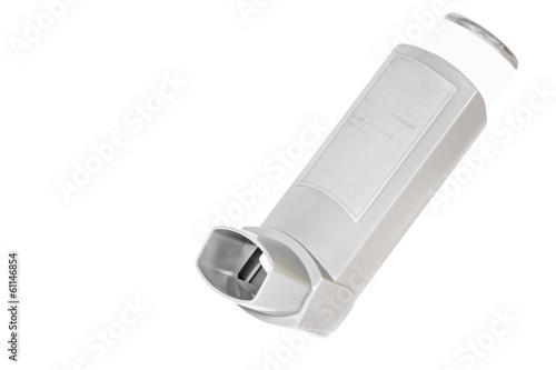 Grey plastic asthma inhaler sprayer, isolated on white