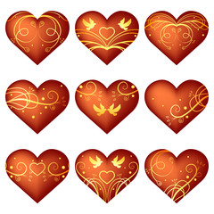 Set of red hearts with golden ornament