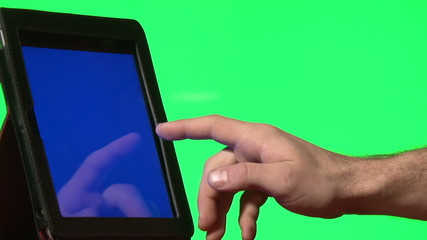 Man using digital tablet with a blue screen