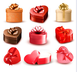 Set of colorful gift heart-shaped boxes with bows and ribbons. V