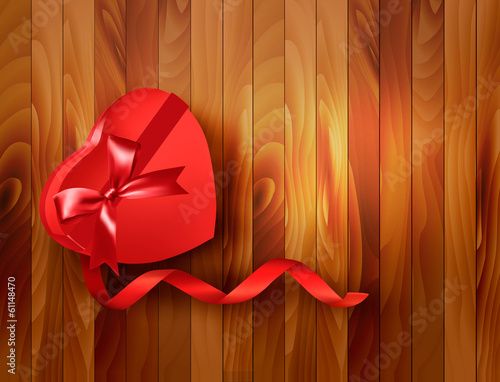 Red heart-shaped gift box with ribbon on wooden background. Vect
