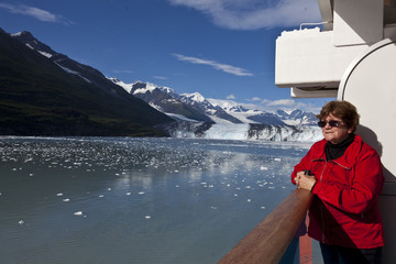Tourist on cruise ship admires scenery in College Fjord