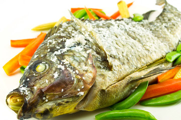 Tilapia grilled on white dish