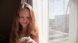 Young Woman Sends SMS Messages to Your Friends