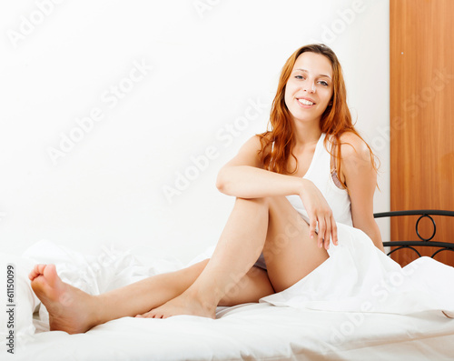 long-haired woman sitting on  sheet