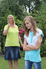 Young teenage girl in an argument with Mother